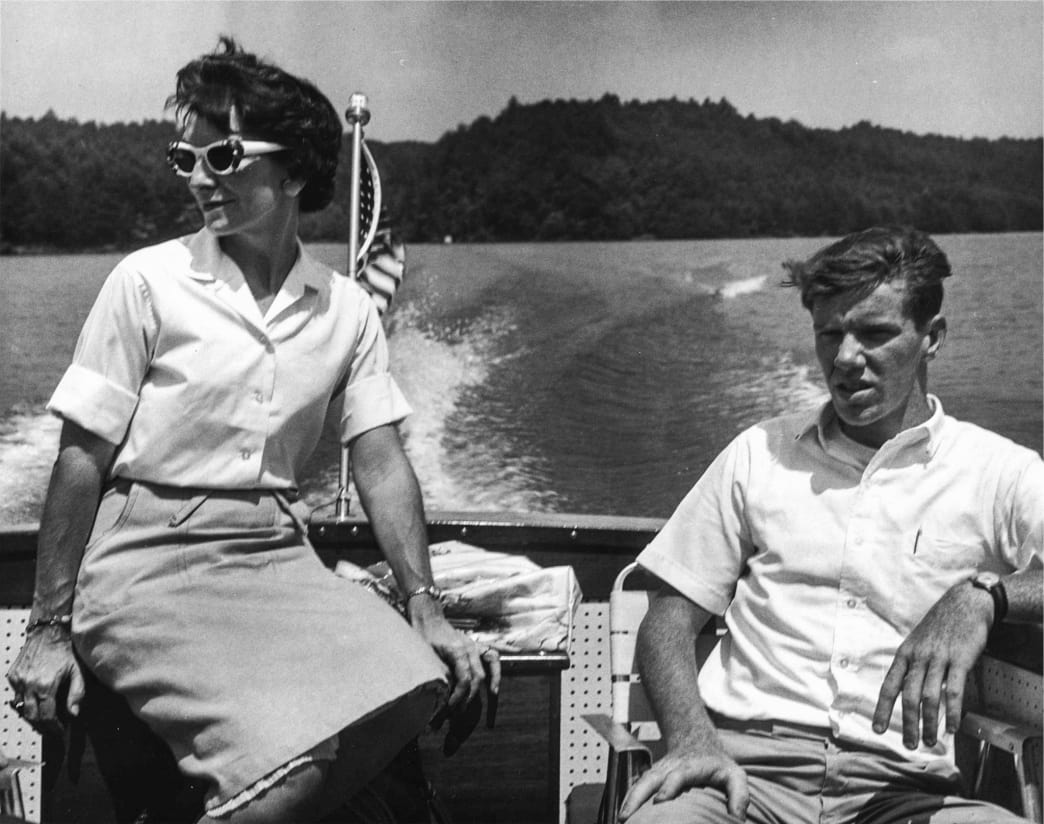 Black and white photo of a man and woman sitting on a boat on Philpott Lake